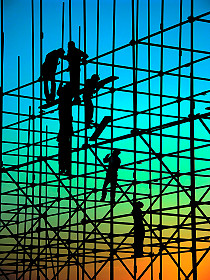 Workers on tall Scaffolding