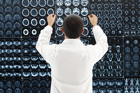 Physician examining images